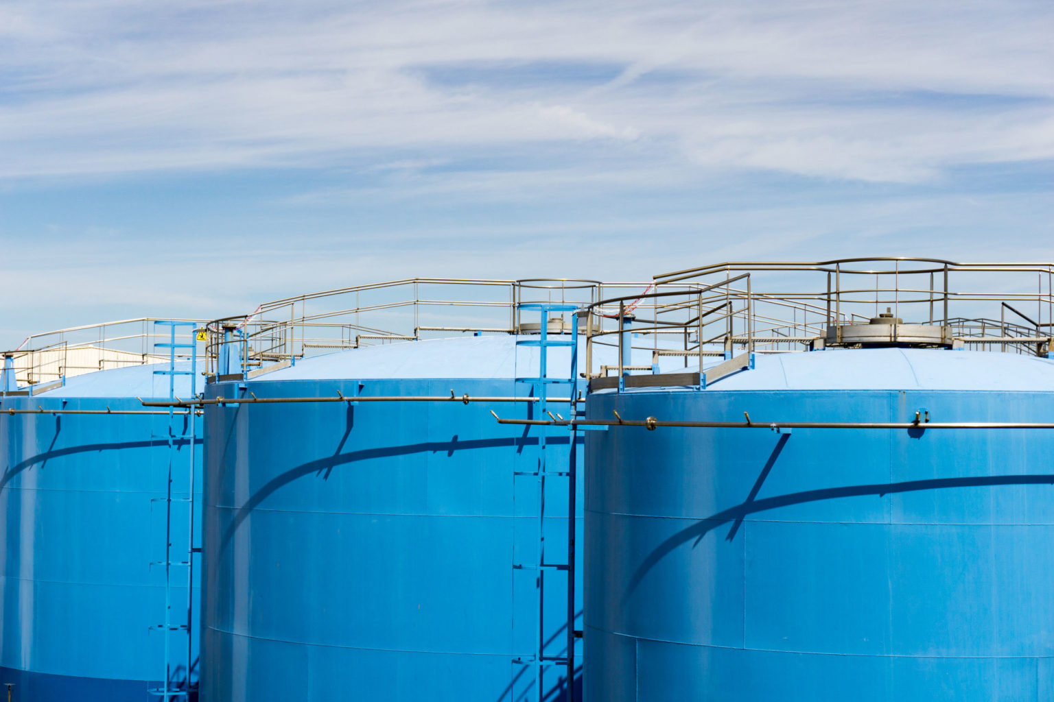Large Blue Indsutrial Silos Or Storage Tanks For Oil Or Other Li