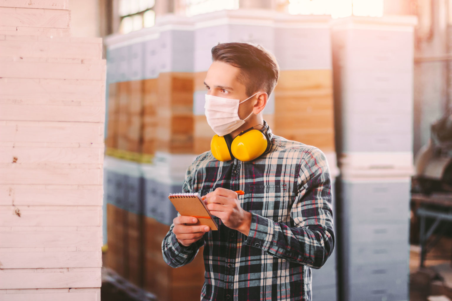 Man Supervisor Inspecting Warehouse During Covid 19 Quarantine